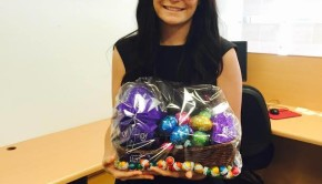 Lily Barry of Elders Real Estate Grafton holding a basket of Easter Eggs for the 2016 Easter Egg Giveaway
