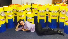 Elders Real Estate Grafton Agent Sam Danvers posing after a long evening of crafting minion outfits for the Jacaranda Festival