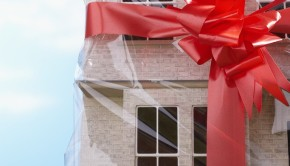 Gift-Wrapped House With Red Bow --- Image by © Royalty-Free/Corbis
